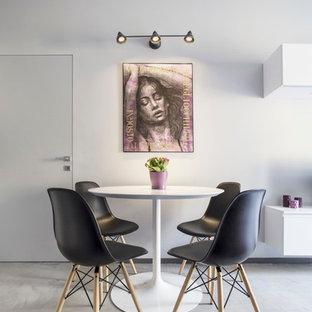Foto di una sala da pranzo design di medie dimensioni con pareti grigie e pavimento in cemento