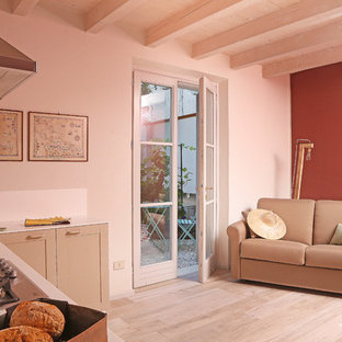 Example of a small farmhouse laminate floor and multicolored floor kitchen/dining room combo design in Milan with multicolored walls and no fireplace
