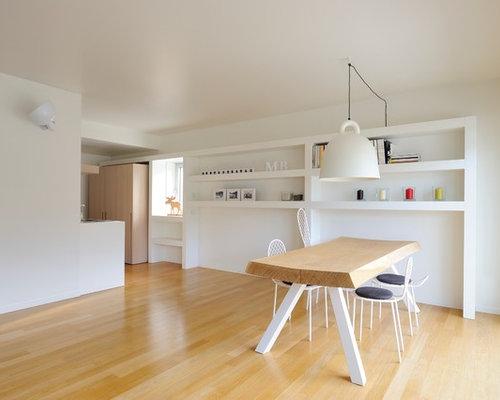 Sala da pranzo aperta verso il soggiorno scandinava foto idee