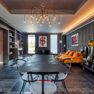 Ispirazione per una sala da pranzo aperta verso il soggiorno eclettica di medie dimensioni con pareti nere, pavimento in legno verniciato, camino classico e pavimento nero