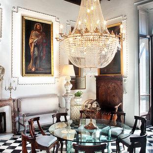 Immagine di una sala da pranzo chic con pareti bianche, camino classico, cornice del camino in pietra e pavimento multicolore