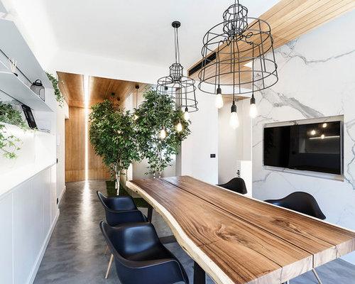 Sala da pranzo contemporanea con pavimento in cemento - Foto, Idee ...
