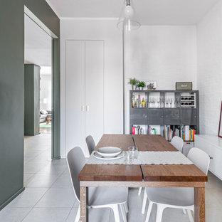 Ispirazione per una sala da pranzo aperta verso il soggiorno minimal di medie dimensioni con pareti verdi, pavimento in gres porcellanato, pavimento beige e pareti in mattoni