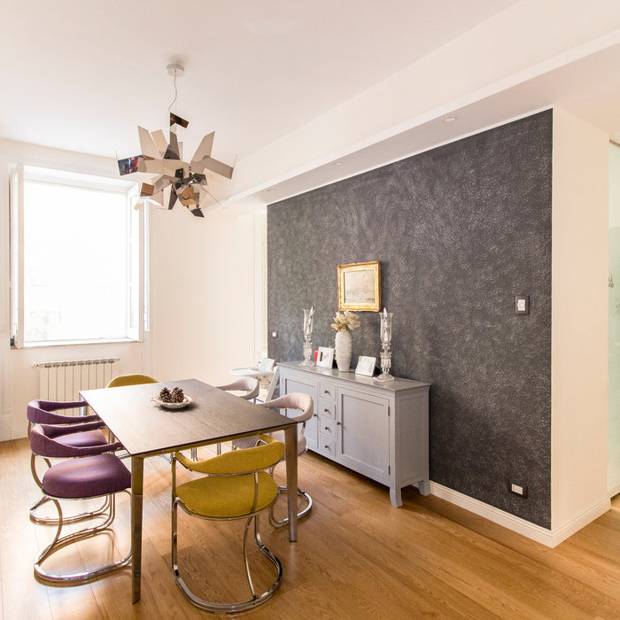 Example of a mid-sized 1950s light wood floor and multicolored floor great room design in Catania-Palermo with multicolored walls and no fireplace