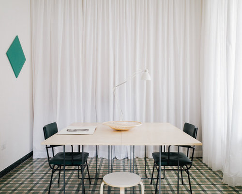 Sala da pranzo moderna con pavimento con piastrelle in ceramica