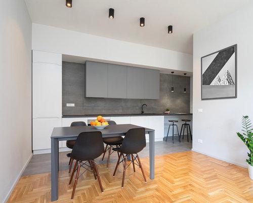 Sala da pranzo aperta verso il soggiorno moderna foto idee