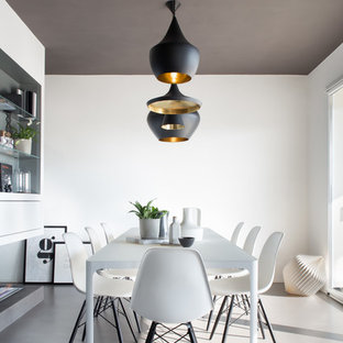 Inspiration for a scandinavian gray floor dining room remodel in Milan with white walls