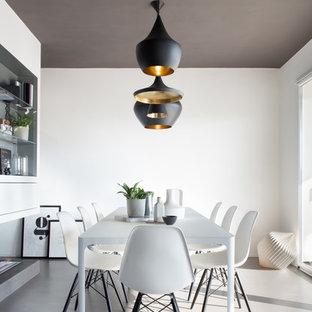 Foto di una sala da pranzo scandinava con pareti bianche e pavimento grigio