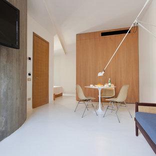 Ispirazione per una sala da pranzo aperta verso il soggiorno minimal di medie dimensioni con pareti bianche