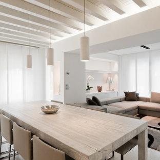 Idee per una grande sala da pranzo aperta verso il soggiorno contemporanea con pareti bianche e pavimento bianco