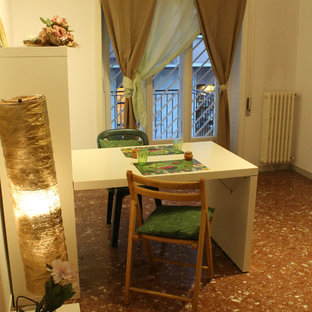 Example of a minimalist dining room design in Rome