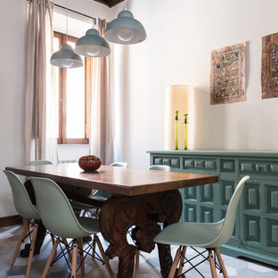Small mediterranean dining room in Rome with white walls, no fireplace and multi-coloured floors.