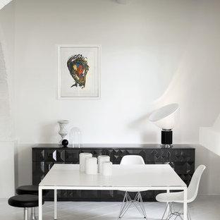 Ispirazione per una sala da pranzo design di medie dimensioni con pareti bianche e pavimento in gres porcellanato