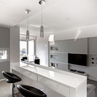 Foto di una sala da pranzo aperta verso il soggiorno contemporanea di medie dimensioni con pareti grigie