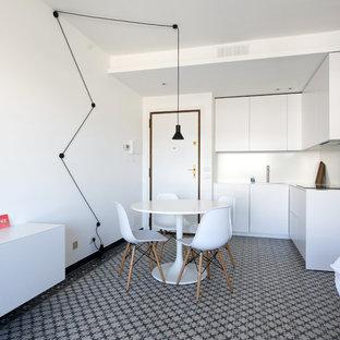 Immagine di una sala da pranzo aperta verso la cucina contemporanea con pareti bianche e pavimento multicolore
