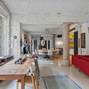 Esempio di una grande sala da pranzo industriale con pareti bianche e pavimento in gres porcellanato