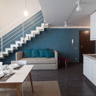 Idee per una sala da pranzo design con pareti blu e pavimento grigio