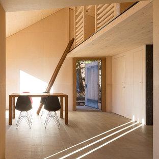 Idee per una sala da pranzo contemporanea con pareti beige e pavimento beige