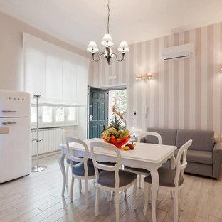 Foto de comedor de cocina romántico, pequeño, con paredes grises, suelo de baldosas de porcelana y suelo blanco