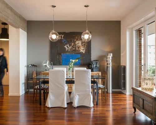 Sala da pranzo aperta verso il soggiorno con pareti grigie for Sala da pranzo e soggiorno