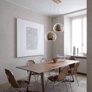 Foto di una sala da pranzo contemporanea di medie dimensioni con pareti grigie e pavimento grigio