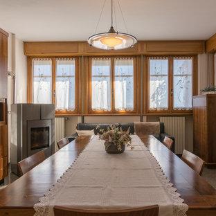 Foto de comedor moderno, extra grande, abierto, con paredes beige, suelo de mármol, estufa de leña, marco de chimenea de metal y suelo multicolor