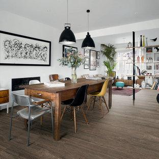 Ispirazione per una sala da pranzo nordica con pavimento in gres porcellanato, pareti bianche e pavimento marrone