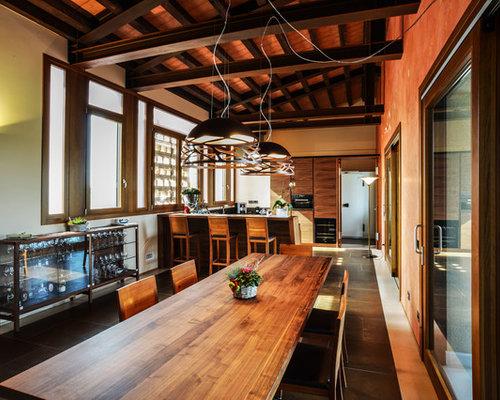 Sala da pranzo con pareti arancioni foto idee arredamento - Pareti sala da pranzo ...