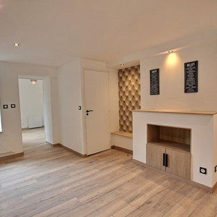 Example of a mid-sized urban laminate floor and beige floor dining room design in Reims with white walls