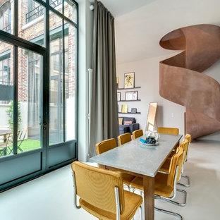 Inspiration pour une grand salle à manger ouverte sur le salon design avec un mur blanc et aucune cheminée.