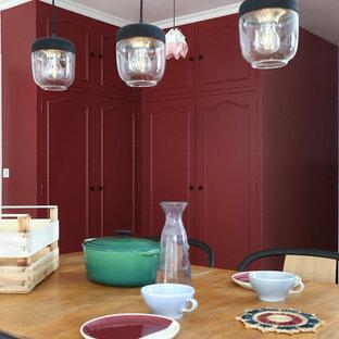 Mid-sized danish light wood floor and beige floor great room photo in Paris with red walls