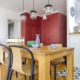 Great room - mid-sized scandinavian light wood floor and beige floor great room idea in Paris with red walls