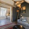 Visite Privée : Esprit chalet dans un studio parisien de 30 m²