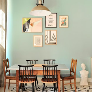 Mid-sized danish dining room photo in Lyon with blue walls