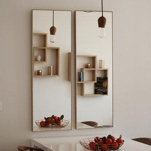 Aménagement d'une salle à manger ouverte sur le salon contemporaine de taille moyenne avec un mur blanc.