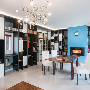 Idées déco pour une salle à manger ouverte sur le salon contemporaine avec un mur bleu et un sol blanc.