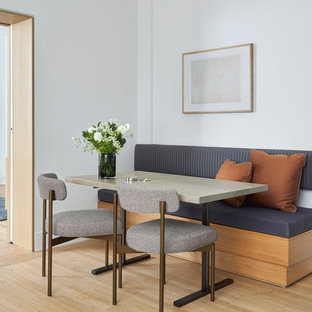 Inspiration for a small contemporary light wood floor dining room remodel in New York with white walls and no fireplace