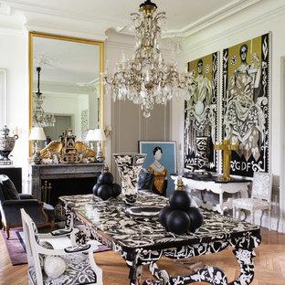 Idées déco pour une salle à manger ouverte sur le salon éclectique de taille moyenne avec un mur blanc, un sol en bois foncé, une cheminée standard et un manteau de cheminée en pierre.