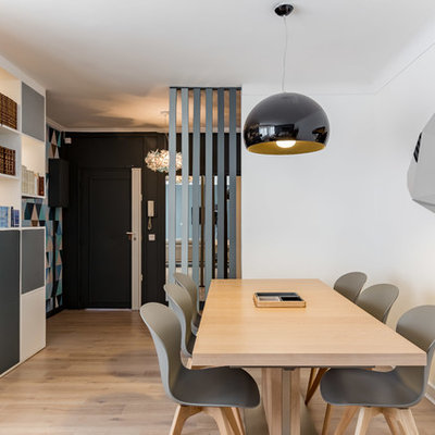 Great room - mid-sized contemporary light wood floor great room idea in Paris with white walls and no fireplace