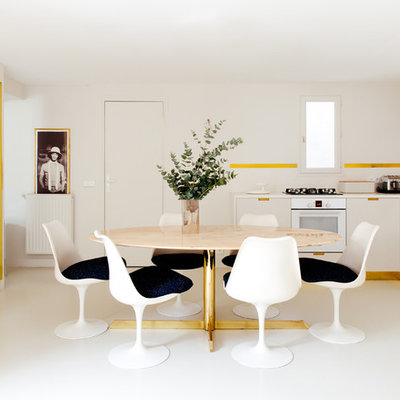 Example of a large trendy white floor kitchen/dining room combo design in Paris with white walls