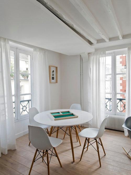 Inspiration pour une salle à manger ouverte sur le salon nordique de taille moyenne avec un