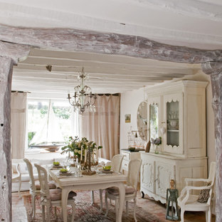 Dining room - country dining room idea in Paris with white walls and no fireplace