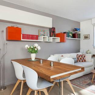 Réalisation d'une salle à manger ouverte sur le salon design de taille moyenne avec un mur gris, un sol en bois clair et aucune cheminée.