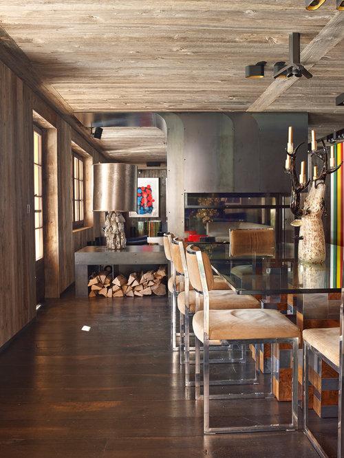 cette image montre une grande salle manger ouverte sur le salon design avec un mur