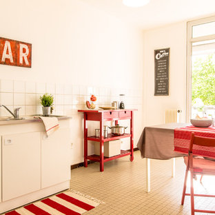 Kitchen/dining room combo - mid-sized cottage kitchen/dining room combo idea in Lyon with white walls and no fireplace