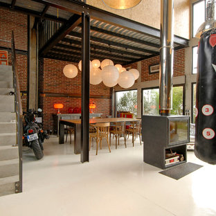 Great room - large industrial great room idea in Paris with red walls