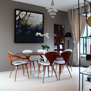 Exemple d'une salle à manger ouverte sur le salon tendance de taille moyenne avec un mur gris et un sol en carrelage de céramique.
