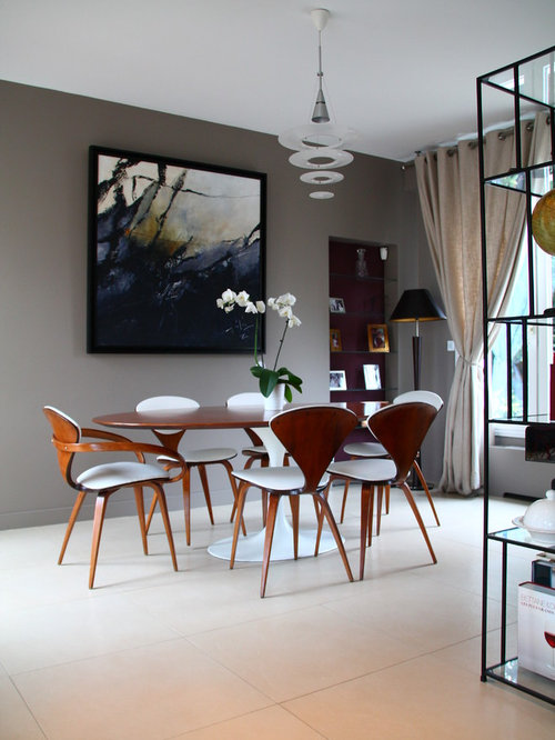 inspiration for a midsized ceramic floor great room remodel in paris with gray
