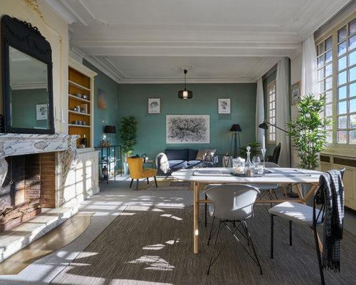 Salle à manger ouverte sur le salon scandinave avec un manteau de ...