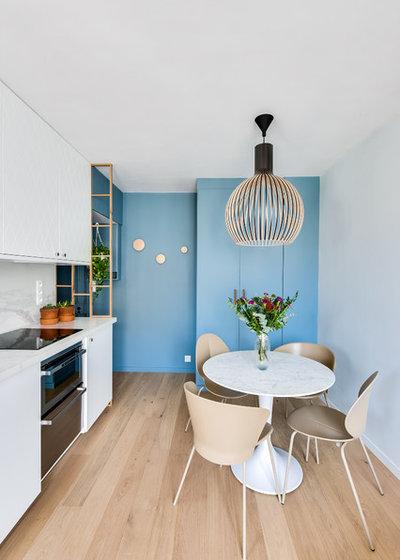 Contemporary Dining Room by Damien Rigondeaud